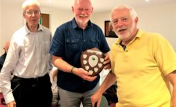 Mike Clutton presenting Jim Barry and Stephen Wallburn, of Colwn Bay Rotary with the Bowling Shield